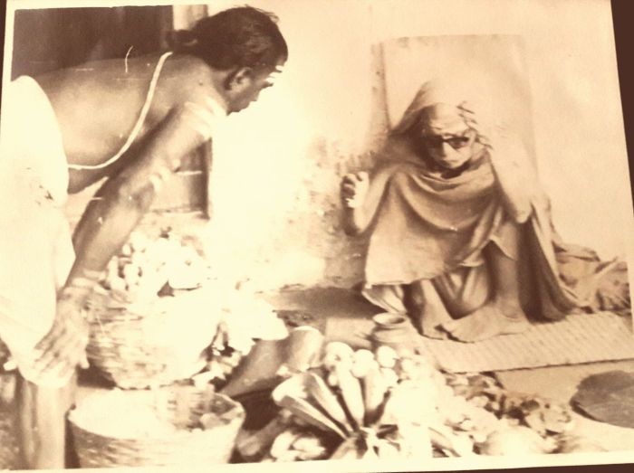 Mahaperiyava-sitting-looking-down-rare.jpg